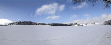 Meadows and woods covered with snow in countryside near Hausen, Royalty Free Stock Images