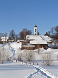 Winter country landscape with a church Stock Image