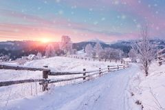Free Winter Country Landscape With Timber Fence And Snowy Road Royalty Free Stock Photos - 103426478