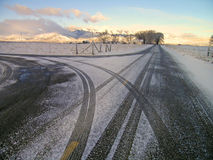 Winter Country Road. With crossroad and car tracks in snow Stock Images
