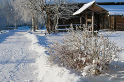 Winter country, wooden well Royalty Free Stock Photos