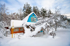 Winter in the countryside. House and garden cowered with snow stock photo
