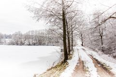 Winter countryside road. In central Europe Royalty Free Stock Photo