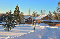 Winter countryside snowy houses cottage in morning Royalty Free Stock Images