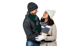 Winter couple enjoying hot drinks Royalty Free Stock Images