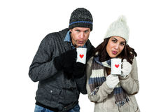Winter couple enjoying hot drinks Stock Photo