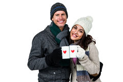 Winter couple enjoying hot drinks Stock Images