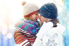 Winter couple. Happy Couple Having Fun Outdoors. Snow. Winter Vacation. Outdoor . Stock Images