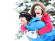 Winter couple happy piggyback royalty free stock photo