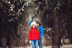 Winter couple having fun playing Stock Photo