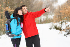 Winter couple hiking Stock Photos