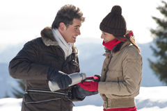 Winter couple with hot drinks Stock Images