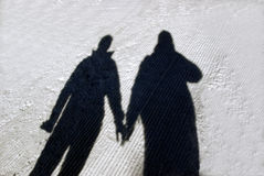 Winter couple shadow Royalty Free Stock Photo