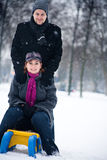 Winter couple on a sled royalty free stock photo