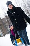 Winter couple in a sled ride Royalty Free Stock Photography