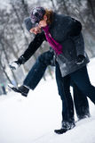 Winter couple taking steps Stock Photo
