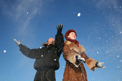 Winter couple throw snow Royalty Free Stock Image