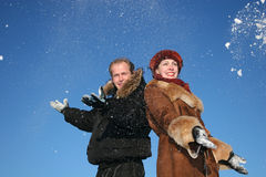 Winter couple throw snow Stock Images