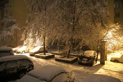 Winter court yard during a snowfall. Royalty Free Stock Images