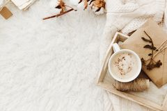 Winter cozy background with cup of coffee, warm sweater and old letters. Flat lay for bloggers Stock Photos