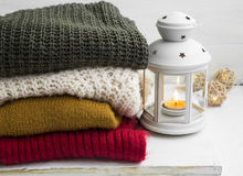 Winter cozy woolen sweaters and candle lantern Stock Photo