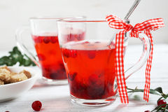 Winter cranberry tea on the boards Royalty Free Stock Photos