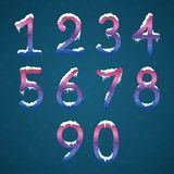 Winter cream numbers set with snow caps. Frozen New year digits. With snowflakes on it kit. Icicles numbers on dark snowy background Royalty Free Stock Photography