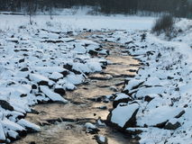 Winter creek. Water which doesn't freeze during the winter Stock Image