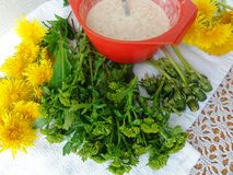Winter cress and dandelions flowers in tempura. Cooking healthy food stock images