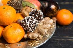 Winter cristmas fruits and nuts on silver plate. With christmas decoration Stock Photo