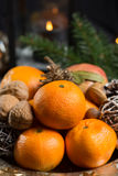 Winter cristmas fruits and nuts on silver plate. With christmas decoration Stock Images