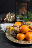 Winter cristmas fruits and nuts on silver plate. With christmas decoration Royalty Free Stock Photo