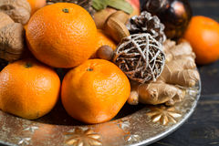 Winter cristmas fruits and nuts on silver plate. With christmas decoration Stock Photos