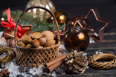 Winter cristmas nuts is wicked basket on white ice. Winter cristmas nuts in wicked basket with christmas decoration Stock Photo