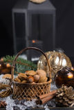 Winter cristmas nuts is wicked basket on white ice. Winter cristmas nuts in wicked basket with christmas decoration Royalty Free Stock Photography