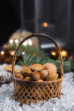 Winter cristmas nuts is wicked basket on white ice. Winter cristmas nuts in wicked basket with christmas decoration Royalty Free Stock Images