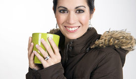 Woman in Winter Wear Holding Green Coffee Cup Stock Photo