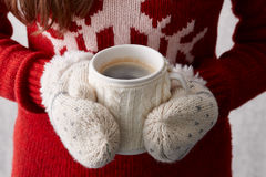 Winter cup of coffee in hands Royalty Free Stock Image