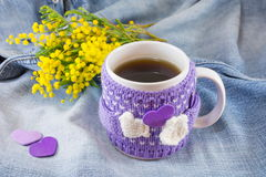 Winter cup of tea and mimosa flowers Royalty Free Stock Photos