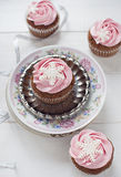 Winter cupcakes. Pink winter cupcakes with snowflakes and silver ribbon Stock Photography