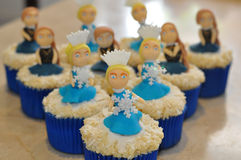 Winter cupcakes. A set of cupcakes with decorations of women with ice crystals Royalty Free Stock Photo