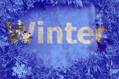 Winter cut out letters on glitter and snowflake background stock image