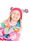 Winter: Cute Smiling Girl in Winter Clothing. Series with little girl in winter clothing. Isolated on white, and also set outdoors stock images