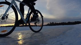 Winter cycling on lake stock footage