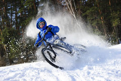 Winter cyclist in snow stock photo