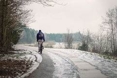 Winter cyclist Royalty Free Stock Photos