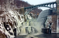 Winter Dam. View of reservoir spillway in winter covered in snow and ice Stock Images