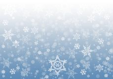 Winter: snowflakes on a blue background Stock Photography