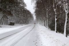 Winter. Dangerous winter road after heavy snowfall. Dangerous winter road after heavy snowfall royalty free stock photography
