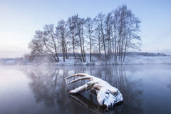 Winter dawn. Cold winter sunrise on the river. Frosty weather Royalty Free Stock Image